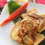 Breakfast, french toast, bananas, cinammon, I think papaya