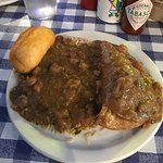 crawfish pie smothered in etouffee with dirty rice