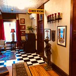Beautiful upstairs parlor, antique decor, old photos, and cute restrooms