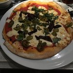Pizza with sun blushed tomatoes, basil, mozzarella and added Jalepenos