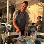 Nestor, our charming waiter de-boning my fish!