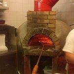 Four à pizza au feu de bois