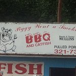 Sign above the smokehouse.