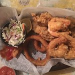 Seafood basket of fried oysters, fried shrimp and onion rings with coleslaw