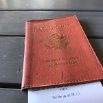 Old passport book becomes an upcycled receipt book.