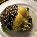 Egg benedict on black bun with Lobster