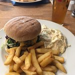 Burger with coleslaw and chips