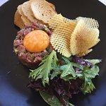 Entree: Steak Tartare: Seasoned raw minced fillet steak, egg yolk, capers, shallots, croutons