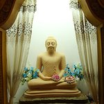 Buddha statue at the entrance.