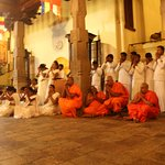 evening Buddhist priests and people praying