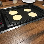Pancakes on the griddle at our table