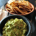 Delicious guacamole and fresh chips.