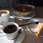 Coffee, meat soup and pancake