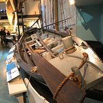 Life size replica of whaling boat.
