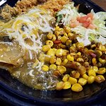 Pork enchilada with rice and Mexican corn. Yum.