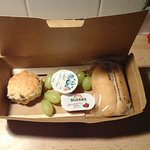 Scrooge-like complimentary snack box in First Class