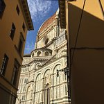 View of the Duomo from a city street