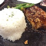 Inihaw na baboy served in sizzling plate
