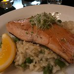 Salmon on a bed of asparagus and pea risotto