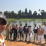 Photo taken with our awesome tour guide, Mr. Kim near the east entrance of Angkor Wat temple