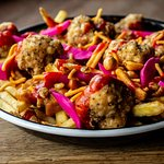 Cauli Gosh, vegan loaded fries with spiced cauliflower, curry sauce, pickles and sriracha