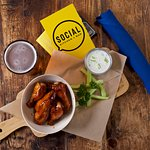 Hot Honey BBQ Wings (Meaty drumettes with hot honey BBQ sauce and cool cucumber ranch dip)
