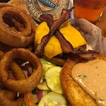 Signature Burger with onion rings and a brew.
