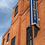Front tower and blue sign at Petoskey Brewing
