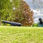 Looking across a ditch at some of the cannons. Beautiful, well kept grounds.