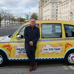 Ian with very distinctive artwork on his Taxi!!