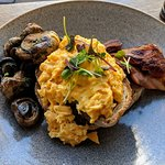 Eggs on toast with bacon and mushroom