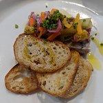 Top view of pork terrine, pickles, wholegrain mustard
