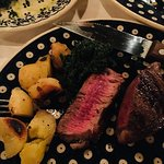 bistecca fiorentina with spinach and potatoes