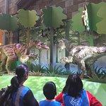 Dinosaurs move around in restaurant. Kids love it