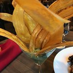 Fried plantain strips with guacamole