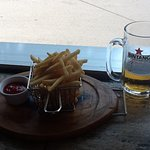 The beer tastes even better with the house fries.