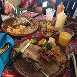Fish a la plancha and chicken enchiladas with mole.