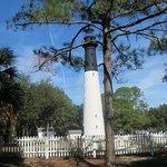 the lighthouse nestled near beach