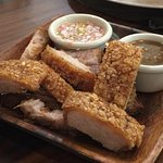 LECHON KAWALI Crispy Pork belly served with homemade mildly sweet/sour liver sauce