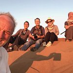 Our second group of guests from Honk Kong and UK enjoying a perfect sunset on the Chegaga Dunes