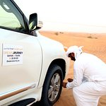 Inflating tyres before heading inside the desert. This provide better traction in sand dunes.