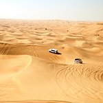 Vehicles slip and slide through the desert dunes