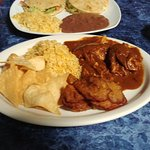Chicken Mole with rice, plantains, and chips