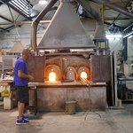 The hot glass furnaces, glass goes in and multiple times when creating this art