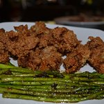 Over fried oysters, asparagus