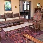 Lobby waiting area; doorway leads to dining room, windows overlook springs