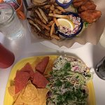 poke, avocado salad with homemade chips also spicy halibut tacos and breaded halibut with slaw/f