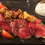 BEEFSTEAK CARPACCIO WITH COTTAGE CHEESE AROMATISED WITH WHITE TRUFFLE OIL