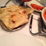 Chicken korma, pilau rice and naan bread
