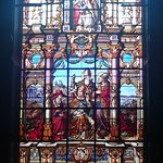 Stain glass window above the altar